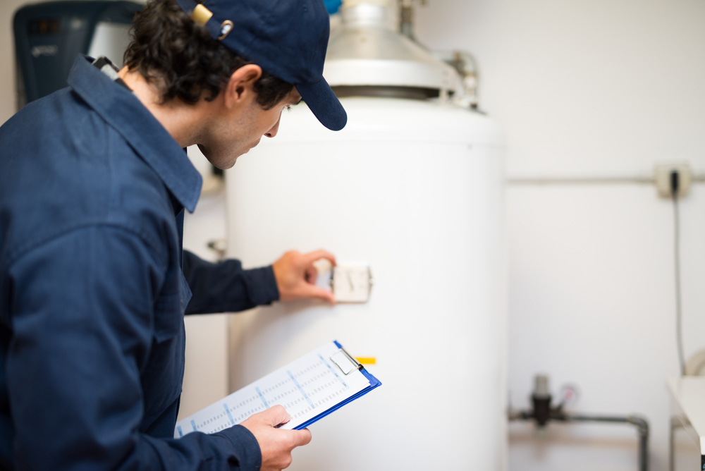 repairman fixing a water heater
